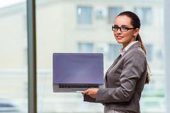 The businesswoman with laptop in business concept Stock Images