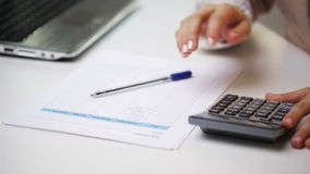 Businesswoman with laptop, calculator and papers stock footage