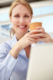Businesswoman on laptop and coffee Stock Photo