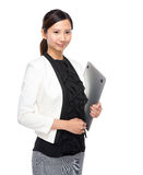 Businesswoman with laptop computer Stock Photography