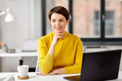 Businesswoman with laptop computer at office stock photos
