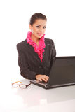 Businesswoman with laptop computer posing Royalty Free Stock Photography