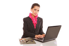 Businesswoman with laptop computer posing stock image