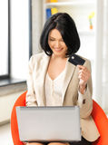 Businesswoman with laptop and credit card Stock Photo