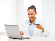 Businesswoman with laptop and credit card Stock Photography