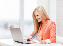 Businesswoman with laptop and credit card Stock Image