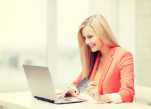 Businesswoman with laptop and credit card Stock Images
