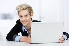 Businesswoman With Laptop At Desk Royalty Free Stock Image