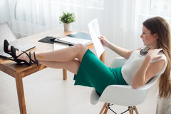 Businesswoman with laptop and diary concept Stock Image