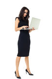 Businesswoman with laptop. Businesswoman dressed in black with laptop isolated on a white background Stock Images