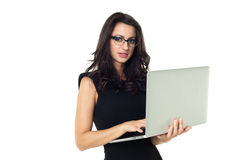 Businesswoman with laptop. Businesswoman dressed in black with laptop isolated on a white background Royalty Free Stock Photography