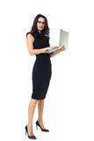 Businesswoman with laptop. Businesswoman dressed in black with laptop isolated  on a white background Royalty Free Stock Photo