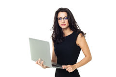 Businesswoman with laptop. Businesswoman dressed in black with laptop isolated on a white background Stock Image