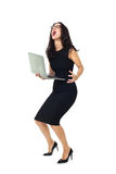Businesswoman with laptop. Businesswoman dressed in black with laptop isolated on a white background Stock Photography