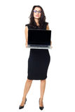 Businesswoman with laptop. Businesswoman dressed in black with laptop isolated  on a white background Stock Photos