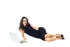 Businesswoman with laptop. Businesswoman dressed in black with laptop isolated on a white background Stock Photo