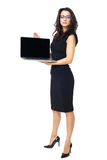 Businesswoman with laptop. Businesswoman dressed in black with laptop isolated  on a white background Royalty Free Stock Image