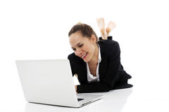 Businesswoman with laptop on the floor royalty free stock photography