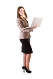 Businesswoman with a laptop in hands isolated on white backgroun Stock Photography