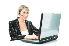 Businesswoman with laptop and headset royalty free stock photography
