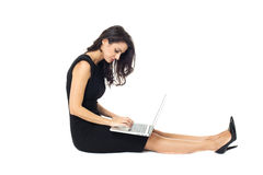 Businesswoman with laptop. Isolated on a white background Royalty Free Stock Photo