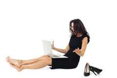 Businesswoman with laptop. Isolated on a white background Stock Photo