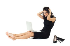 Businesswoman with laptop isolated on white background. Businesswoman dressed in black with laptop isolated on a white background Royalty Free Stock Images