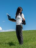 Businesswoman with laptop on a meadow. Pictures from photo shoot - a woman with a computer in nature - Slovakia 2012 royalty free stock images