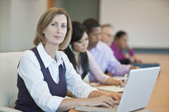 Businesswoman With Laptop And Multiethnic Colleagues Stock Image