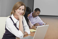 Businesswoman With Laptop And Multiethnic Colleagues Royalty Free Stock Photos
