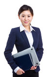 Businesswoman with laptop and notebook Stock Photo