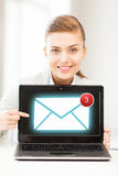 Businesswoman with laptop in office Stock Images