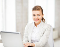 Businesswoman with laptop in office Stock Photography