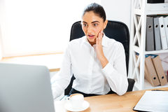 Businesswoman with laptop at the office Royalty Free Stock Image