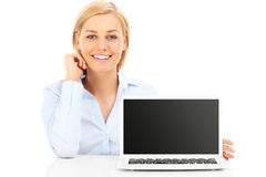 Businesswoman and laptop Stock Image
