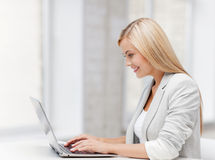 Businesswoman with laptop Royalty Free Stock Photography