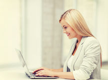Businesswoman with laptop Stock Photo