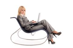 Businesswoman with laptop rest in chair over white Stock Photos