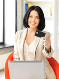 Businesswoman with laptop showing credit card Stock Images