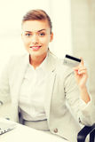 Businesswoman with laptop showing credit card Royalty Free Stock Image