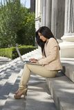 Businesswoman with laptop at staircase Royalty Free Stock Photography