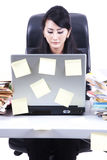 Businesswoman with laptop and sticky note. Businesswoman working on her desk with laptop full with sticky note Royalty Free Stock Photos