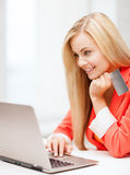 Businesswoman with laptop using credit card Royalty Free Stock Photography
