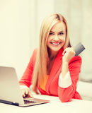 Businesswoman with laptop using credit card Royalty Free Stock Image