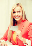 Businesswoman with laptop using credit card Stock Photo