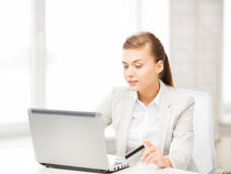 Businesswoman with laptop using credit card Stock Photos