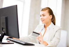 Businesswoman with laptop using credit card Stock Images