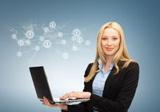 Businesswoman with laptop and virtual screen Royalty Free Stock Image