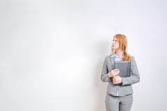 Businesswoman before a Large White Wall Royalty Free Stock Images