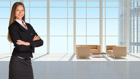 Businesswoman and large window in office building Royalty Free Stock Photo
